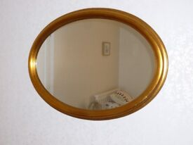 Mirrors x2. 1.gold oval shape. 2. solid wood rectangle