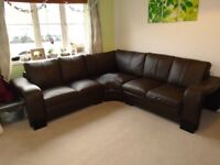 Damaged brown leather effect corner sofa - free to collector