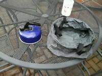 Blue whistling kettle and folding washing up bowl for camping
