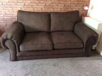 Brown 2/3 seater sofa bed.