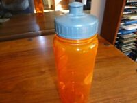 brand new never used water bottle. nice orange & grey colour