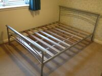 Metal double bed frame for sale.