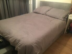 Grey suede double divan bed with headboard and orthopaedic mattress