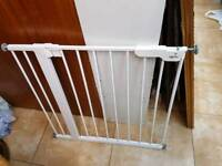 Child safety gate with pressure bolts