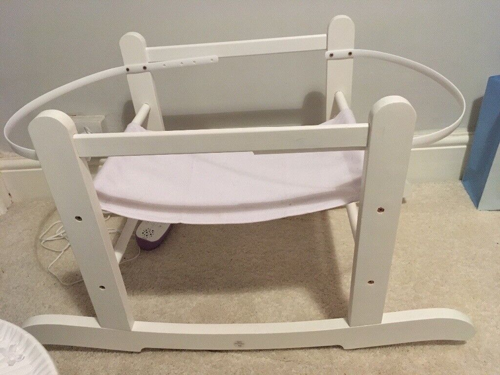 White moses basket and stand. Used for 2 months