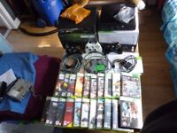 2 xbox 360 consoles with 21 games and 3 controllers elite and go