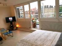Big room with sofa and balcony