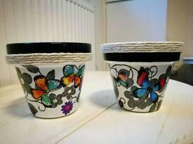 Handmade decoupage pots.