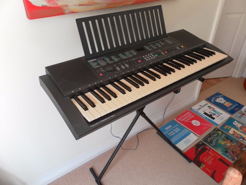 Elecric Piano Keyboard Yamaha PSR 300 with stand and music books