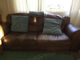 Leather sofas and footstool.