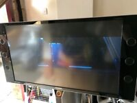 Samsung 50 inch tv with built in speakers. One integrated unit .