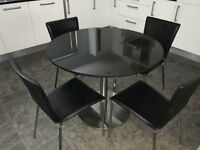 Dining Table, Black Granite c/w 4 Black Leather Chairs, Stainless Steel Legs.