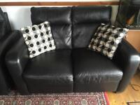 Black leather set of luxury sofas