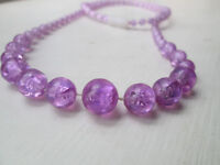 Three vintage long bead necklaces in white, mauve and green
