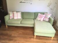 Green IKEA sofa with chaise