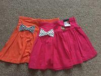 BNWT set of 2 summer skirts age 8-9
