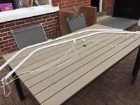 Swish corded white plastic curtain track for bay window.