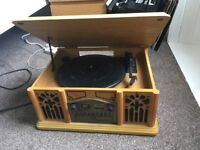 Record player, plays vinyl, CD's, tapes, radio and music from phone when connected