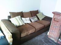 Free dark brown 3 seater sofa, good condition.