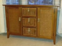 Wood and rattan sideboard.