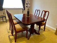 Polished wooden dining room table and 4 chairs