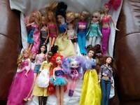 Assorted dolls including Barbie and Disney