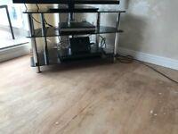 Corner tv stand black glass. Good condition