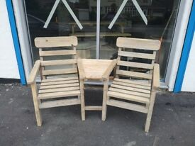 A pair of reclaimed and refurbished love chairs. Solid build made to last.