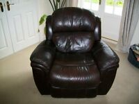 Brown leather reclining sofa and reclining armchair. Both in good condition.