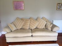 Large sofa, beige colour, well used but still with some life left