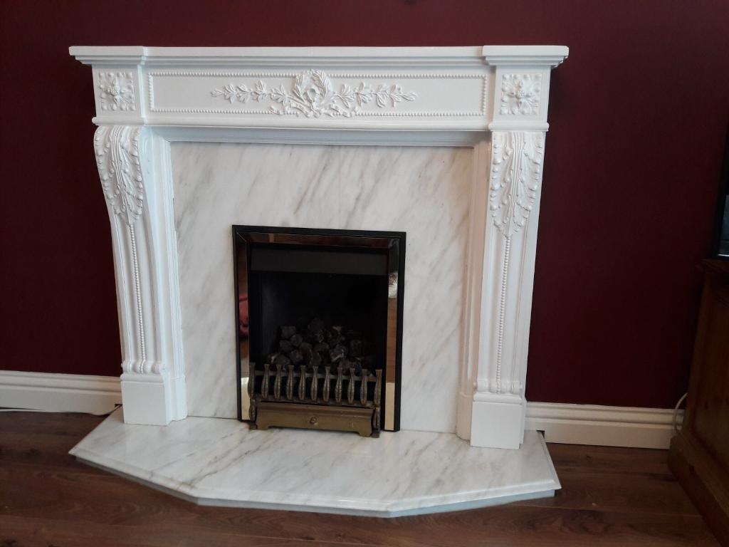 Gas fire, surround and hearth.