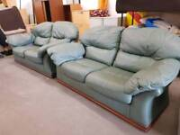 Green leather twin two seater sofa suite (with zip on cushions)