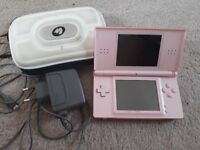 Pink Nintendo DS Lite with charger and case
