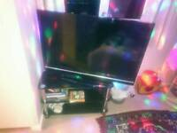 "42"" HD LCD television and stand"