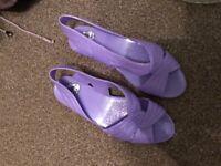 Lilac plastic shoes
