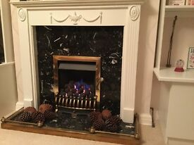 Gas Fire. Kinder Oasis Coal Effect with hearth and mantlepiece.