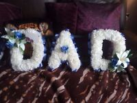lovely funeral flowers saying DAD