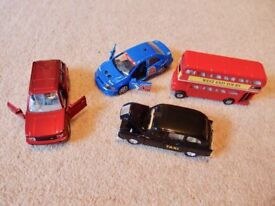 THREE CARS AND A BUS TOY VEHICLES