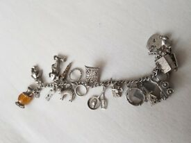 Silver plated charm bracelet 18 charms