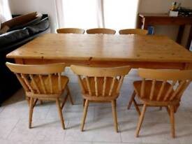 Large pine kitchen/dining table and 6 chairs. Comfortably seats 8 people.