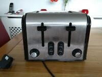 A 4-slice toaster plus matching bread, coffee, tea, sugar, biscuit and cutlery storage bins