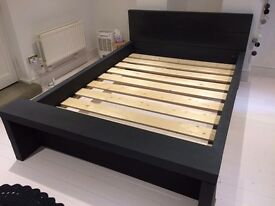 Wooden beam kingsize bed