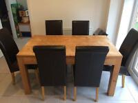 Wooden kitchen dining table with leather chairs
