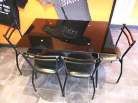 Black glass top table and chairs two sets