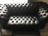 Black chesterfield sofa