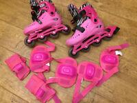 Pink inline roller blades plus safety padding