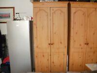 2 pine effect wardrobes