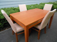 Extending dining table with 4 chairs. Can deliver
