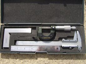 Engineers measuring set in fitted case