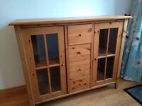 Oak sideboard with drawers and display shelves.